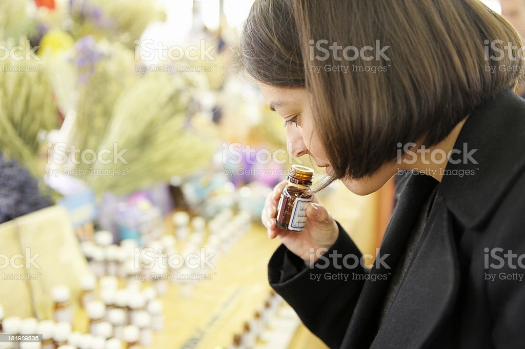 Smelling Essential Oils on a Market Stall stock photo