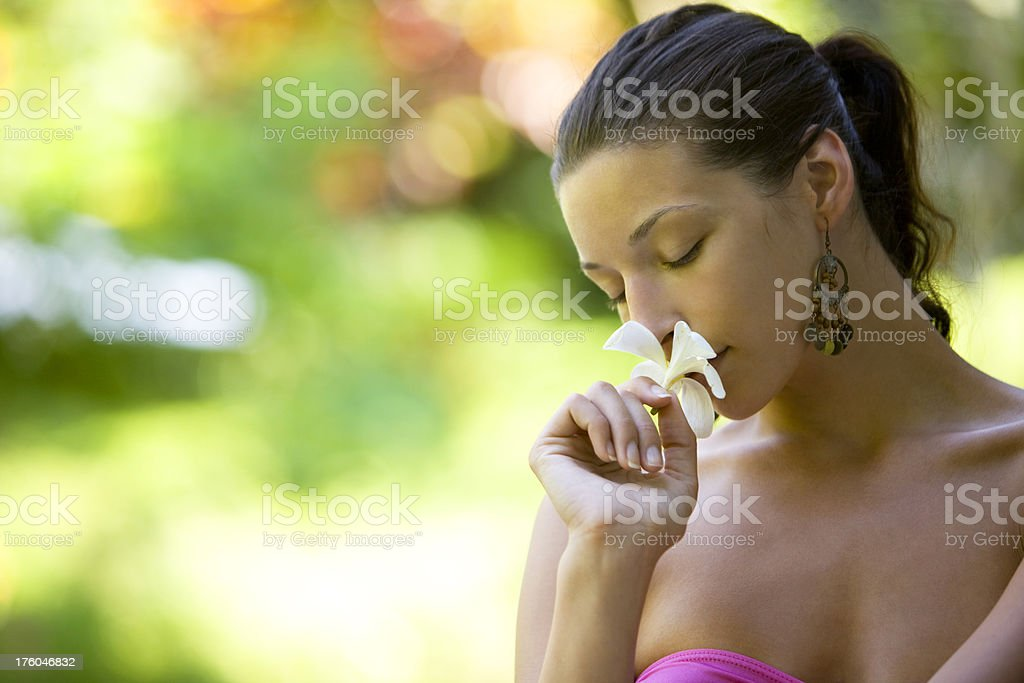 Smelling flower royalty-free stock photo