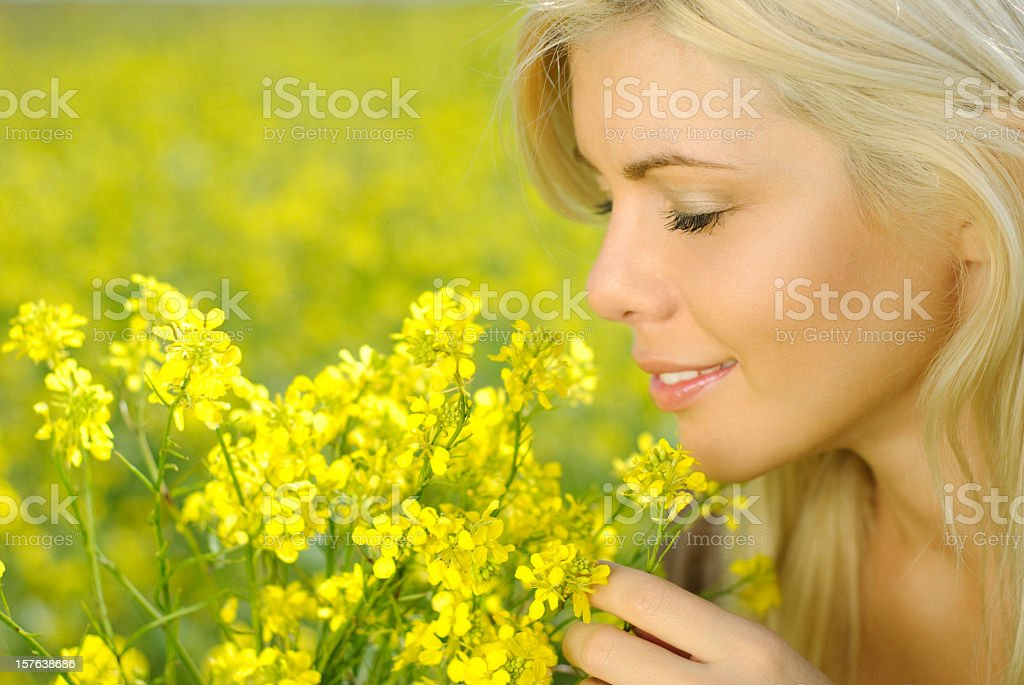 Smelling flowers royalty-free stock photo