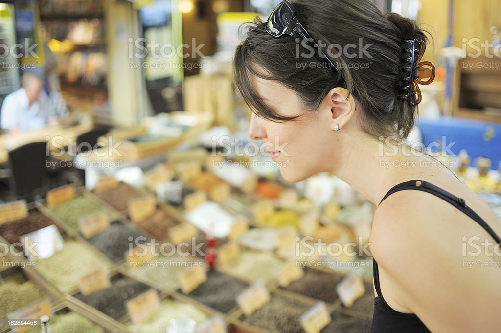 Smelling Spices at the Market royalty-free stock photo