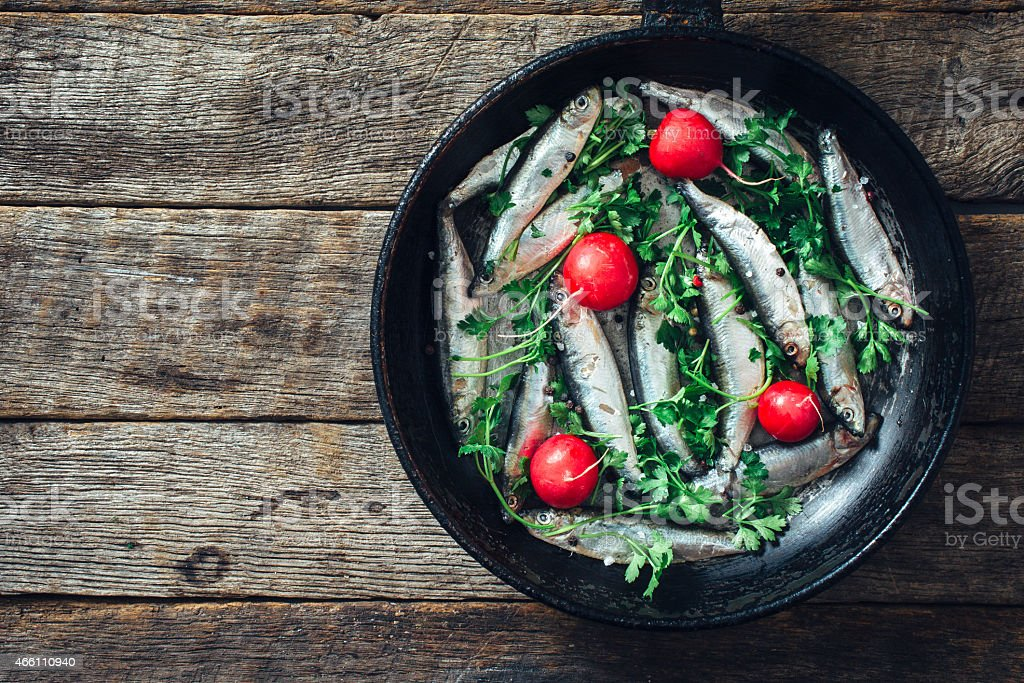 Smelt fish in the pan stock photo