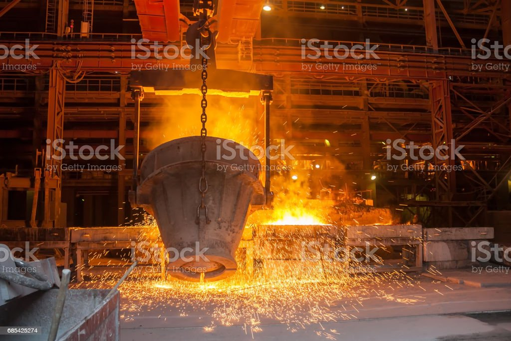 Smelting metal in a metallurgical plant стоковое фото