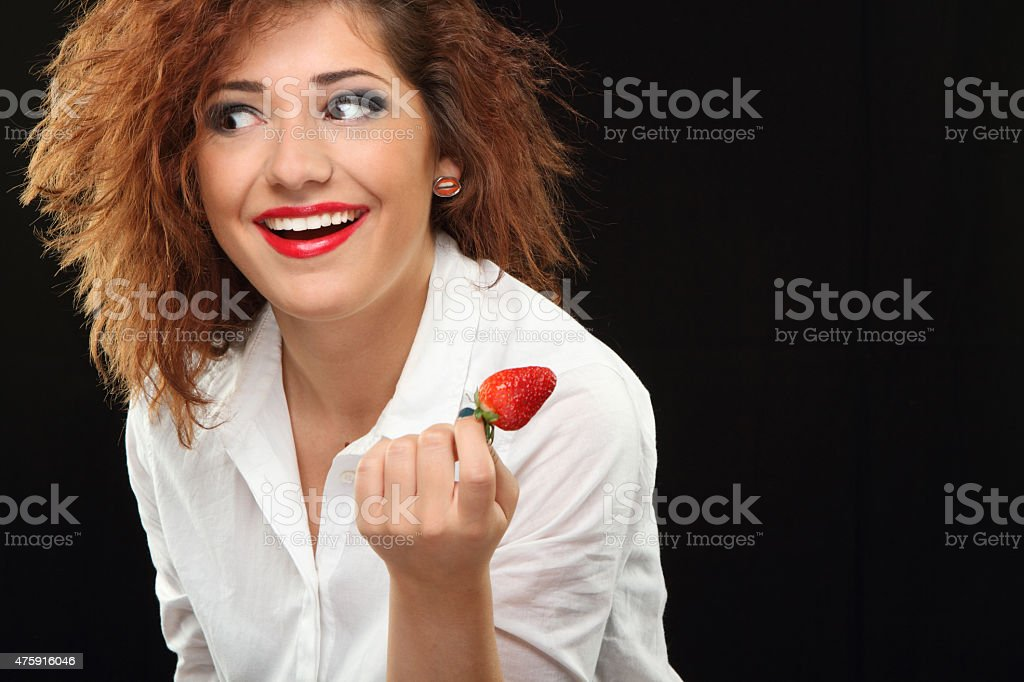 Smile and strawberries stock photo