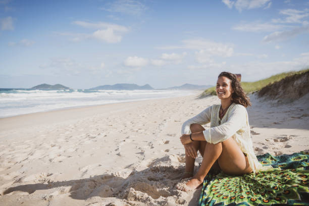 Smile and sunlight at beach in Florianopolis, Brazil stock photo