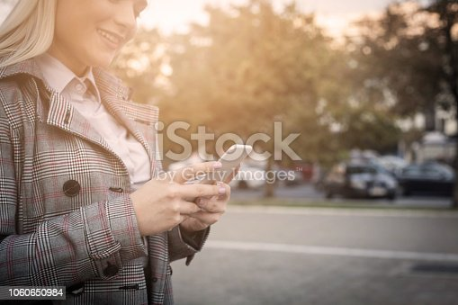 855341616istockphoto Smile because texting to you. 1060650984