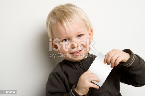 istock smile boy with card for text 91684243