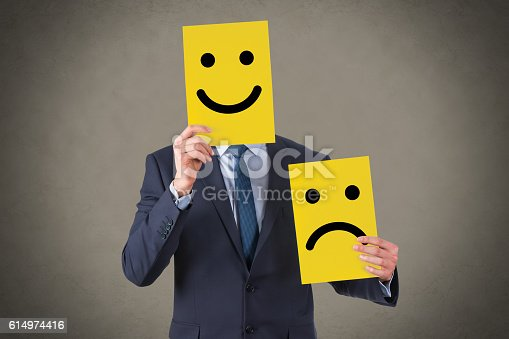 istock Smile Face Drawing on Cardboard 614974416