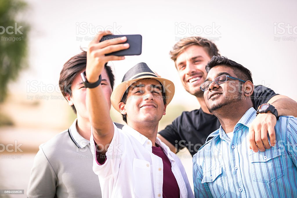 smile for the camera guys stock photo more pictures of adolescence