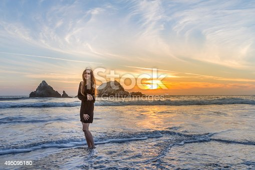 Smile Freedom and happiness woman on beach. She is enjoying serene ocean nature outdoors.