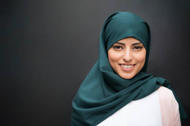 Smile From The East Portrait of a beautiful smiling muslim woman wearing hijab. religious veil stock pictures, royalty-free photos & images