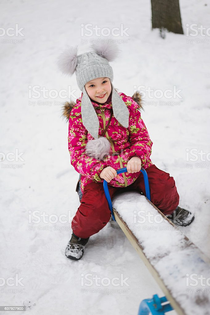 smile girl sitting on a teeter-totter stock photo
