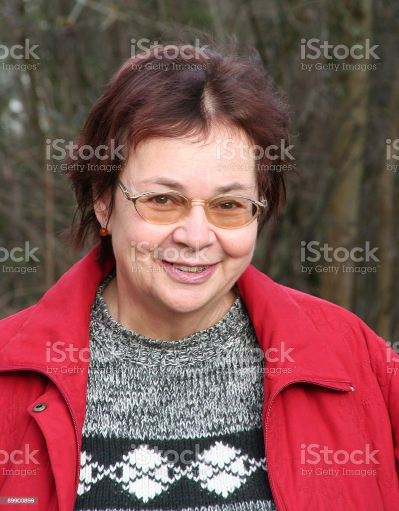 smile of a senior woman in winter cloth royalty-free stock photo