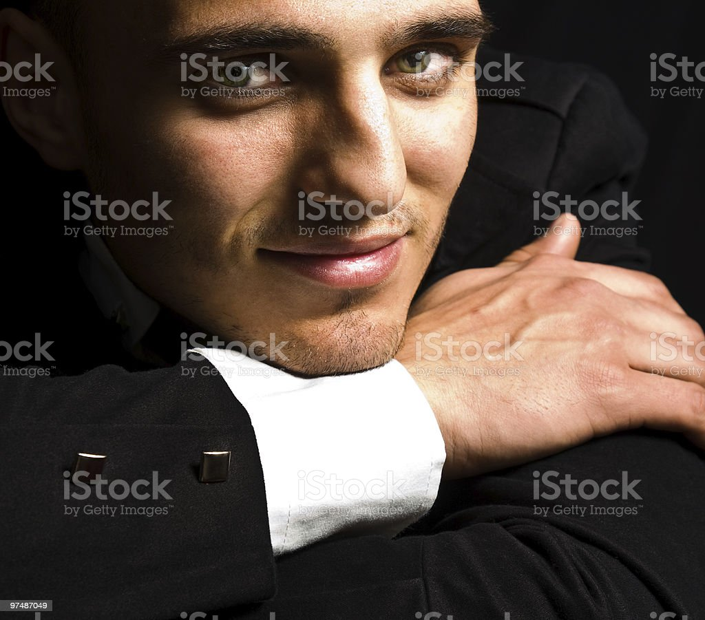 Smile of elegant handsome man with sensual eyes royalty-free stock photo