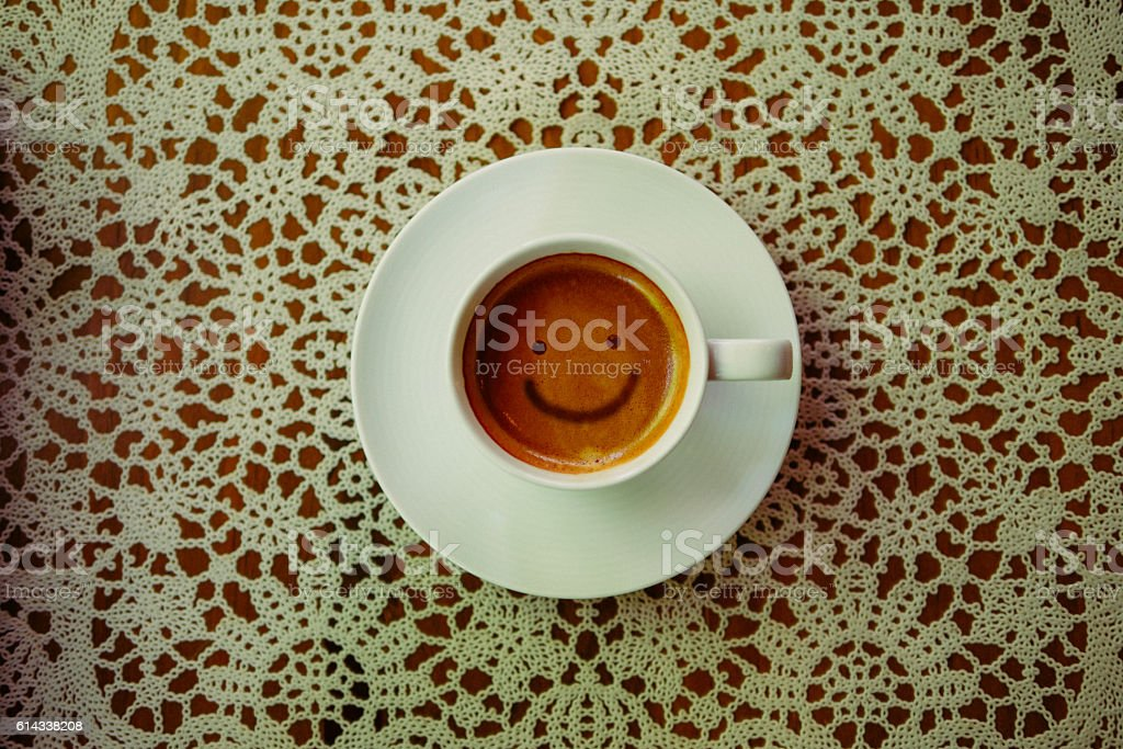 Smile of Espresso Coffee Drink in Simple White Mug stock photo