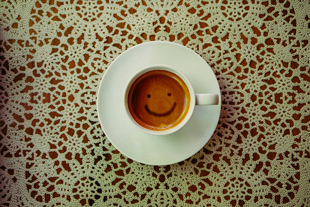 Smile of Espresso Coffee Drink in Simple White Mug - Photo