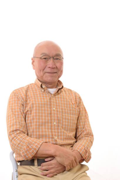 メガネの笑顔と日本人シニア ストックフォト