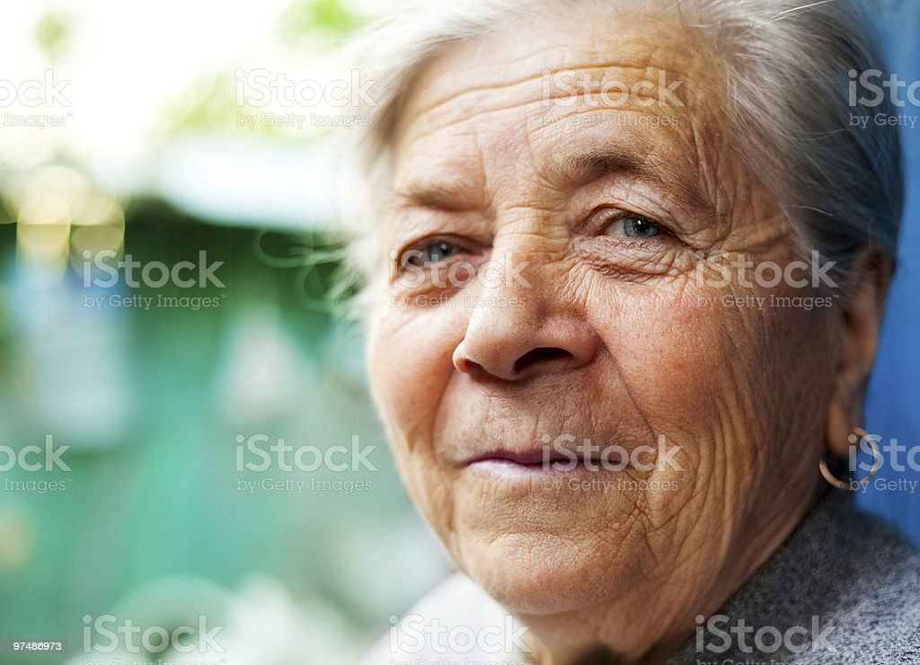 Smile of one content happy senior woman royalty-free stock photo