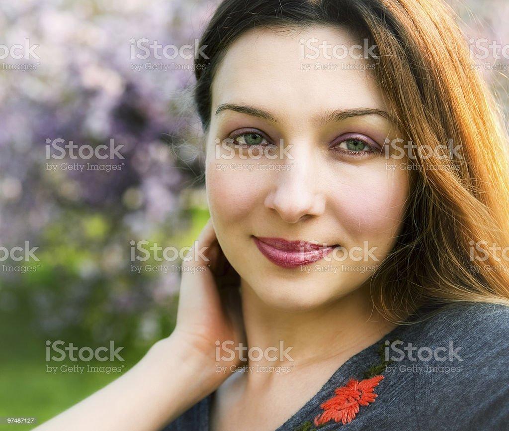 Smile of sensual serene beautiful woman outdoor royalty-free stock photo