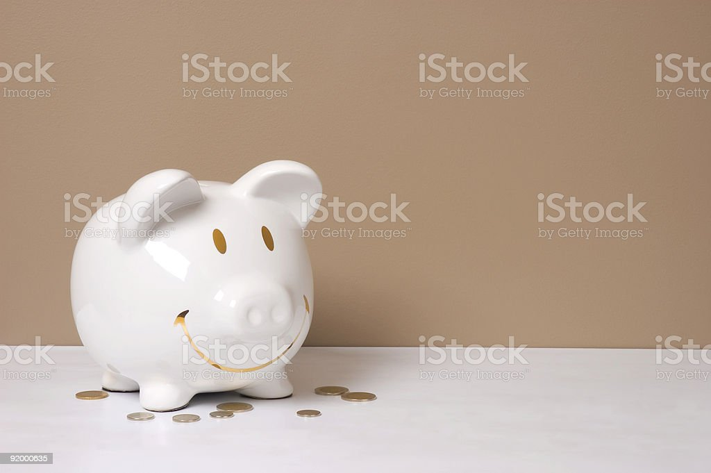 Smile Piggy Bank with Coins royalty-free stock photo