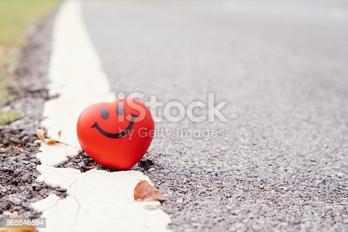823097608istockphoto Smile red heart beside road,health, medicine and charity concept. 965546594