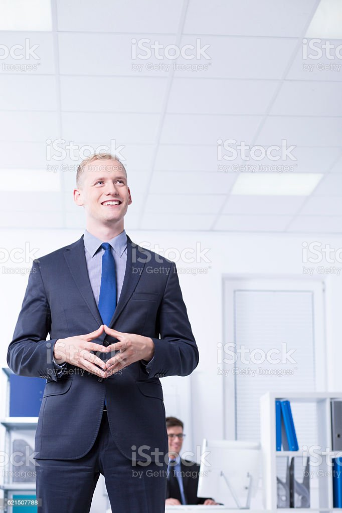 Smiled man in suit in bright office foto stock royalty-free
