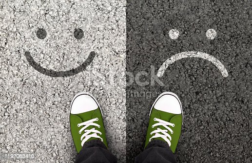 istock Smiles drawn on asphalt road, pros and cons 1192083410