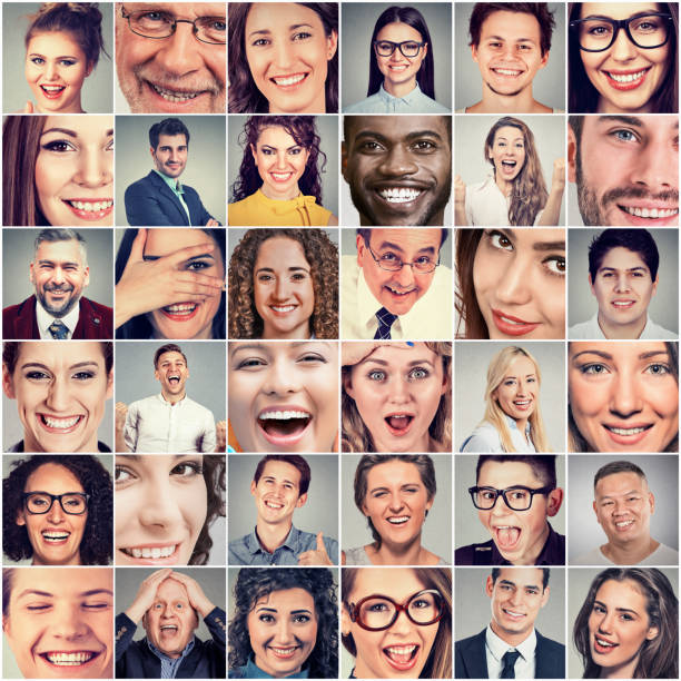 Smiles. Happy men and women stock photo