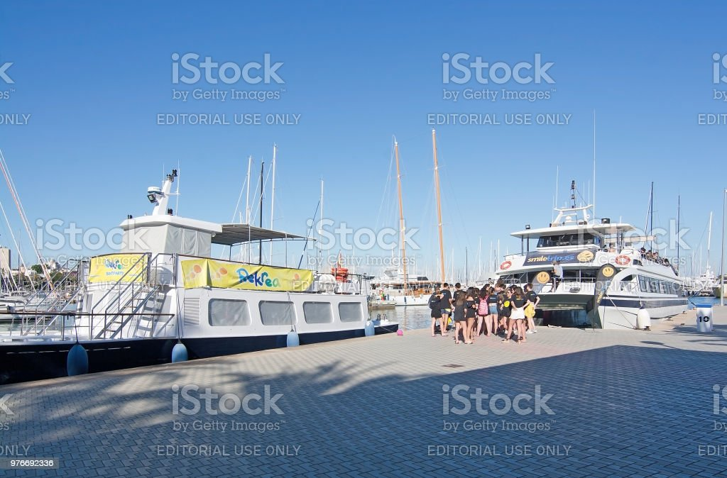 Smiletrip boat with youth getting onboard stock photo