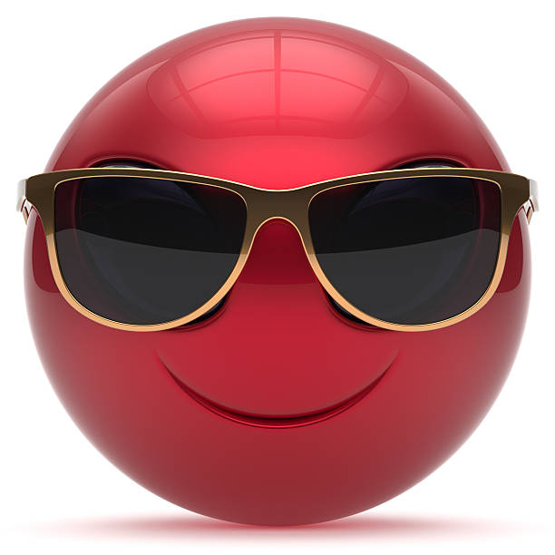 Smiley alien face cartoon sunglasses head emoticon ball red stock photo