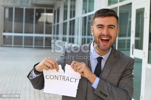 656916072istockphoto Smiley businessman breaking a contract 992220286