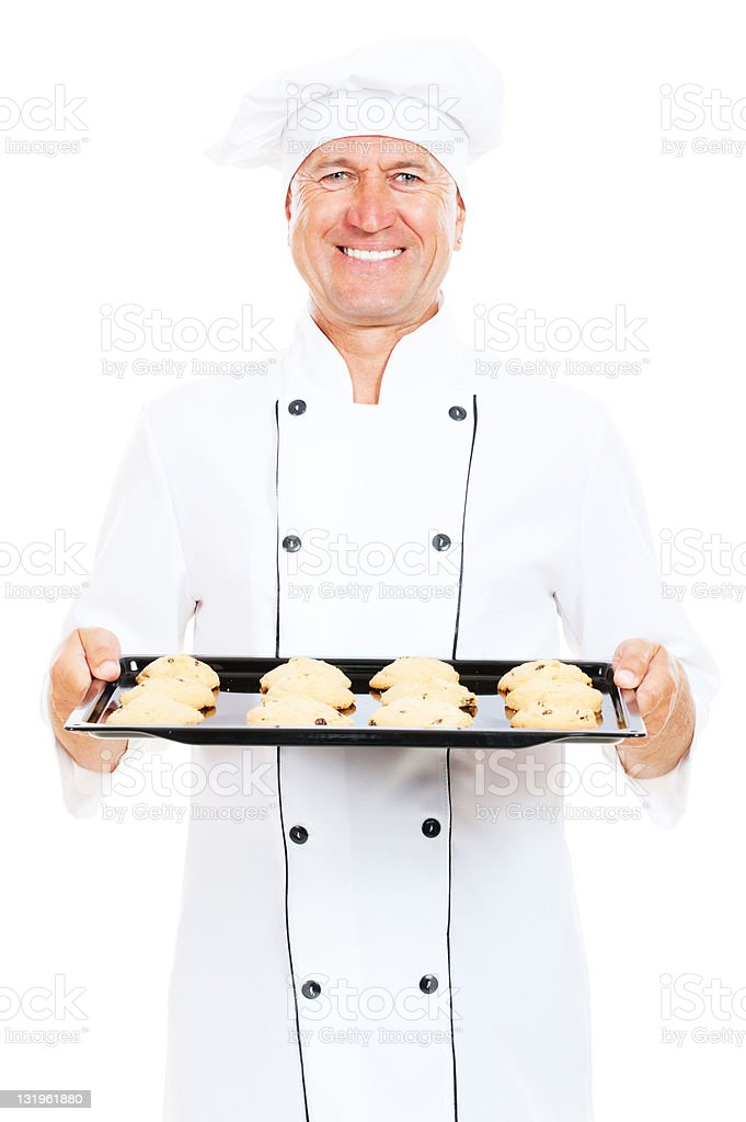 smiley cook holding baking tray with cookies royalty-free stock photo
