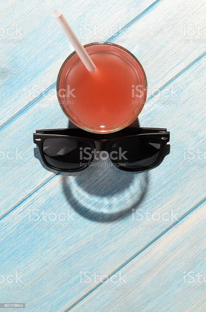 smiley drink on beach table stock photo
