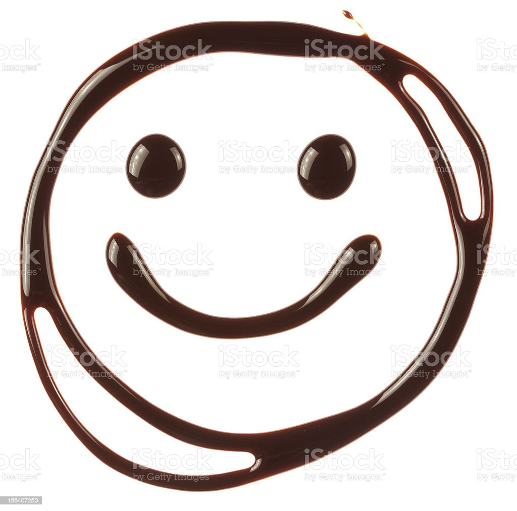 Smiley face made of chocolate syrup stock photo