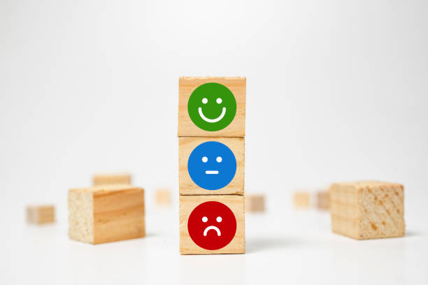 smiley face on wood block cube - business services rating customer experience, Satisfaction survey concept - Feedback stock photo