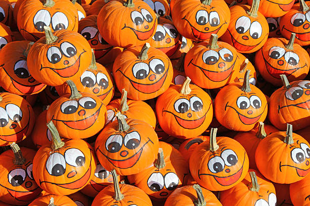 Smiley faces painted on Pumpkins stock photo