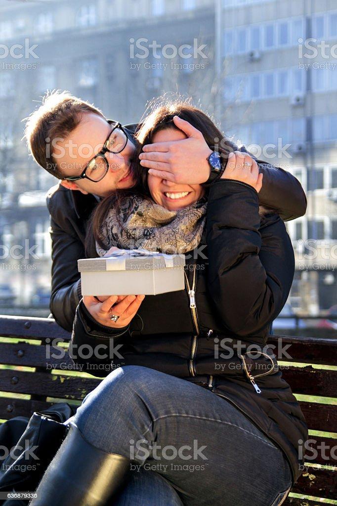 Smiley girl receives a present from boyfriend for valentine day - foto de acervo
