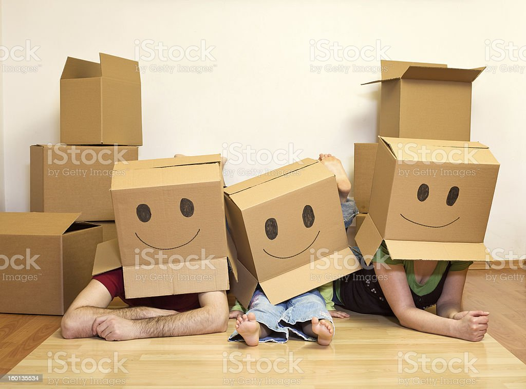 Smiley moving family - couple with a kid stock photo