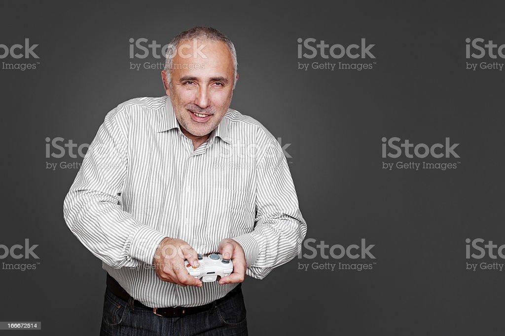 smiley senior man with joystick royalty-free stock photo
