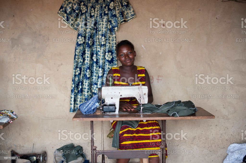 Smiley Young Tailor stock photo
