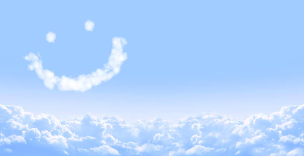 smilie from cloud in blue sky - smiley face stock photos and pictures