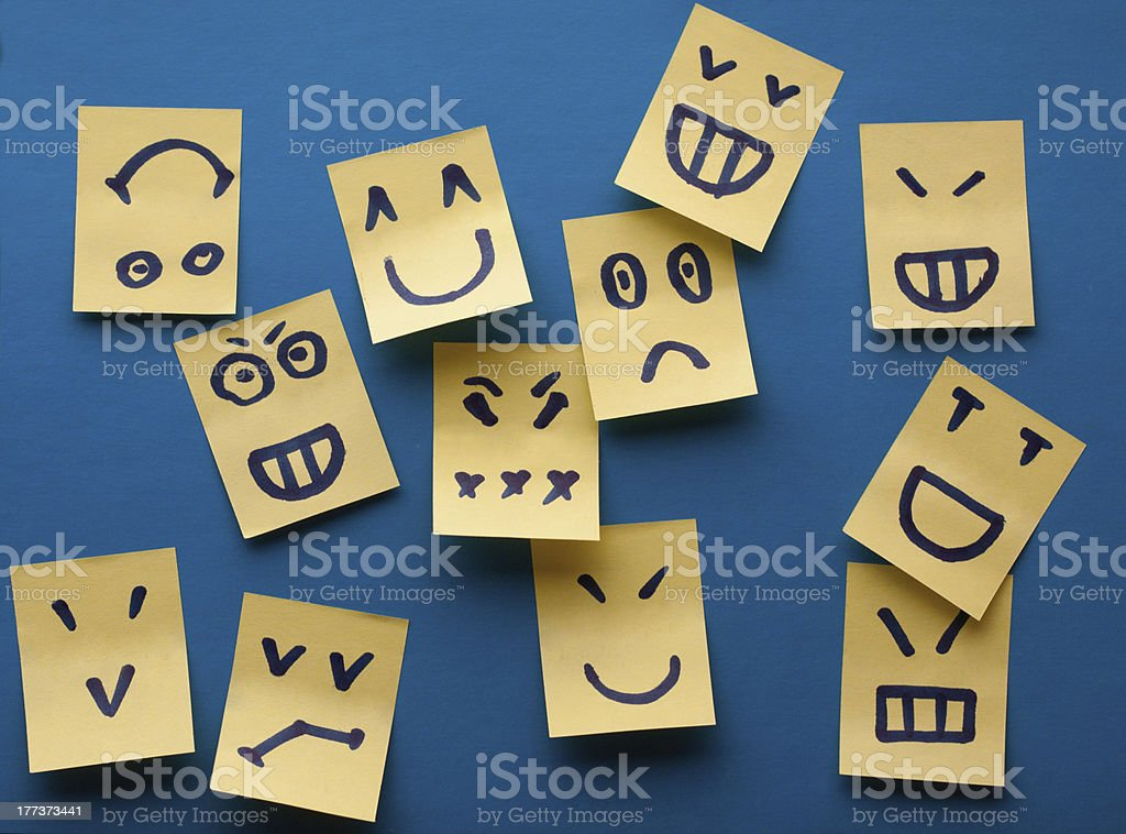Smilies yellow stickers on blue background stock photo