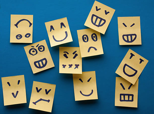 smilies yellow stickers on blue background - emotion stock pictures, royalty-free photos & images
