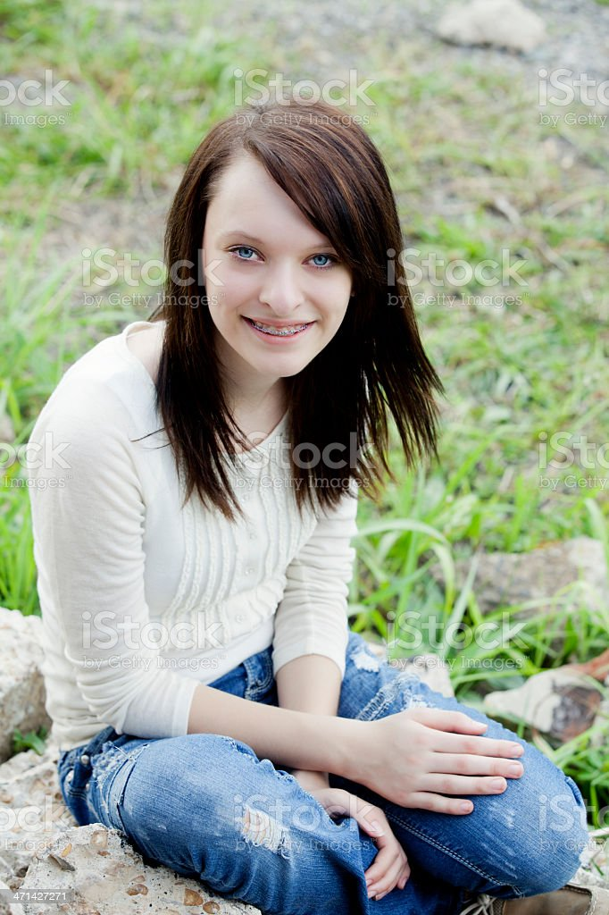 14 Year Old Girl Sitting Crossed Legged On Her Bed Stock: Smiling 14year Old Girl With Braces Outdoors Stock Photo
