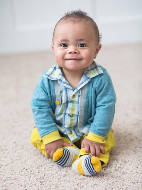 Smiling Adorable diverse baby boy portrait stock photo