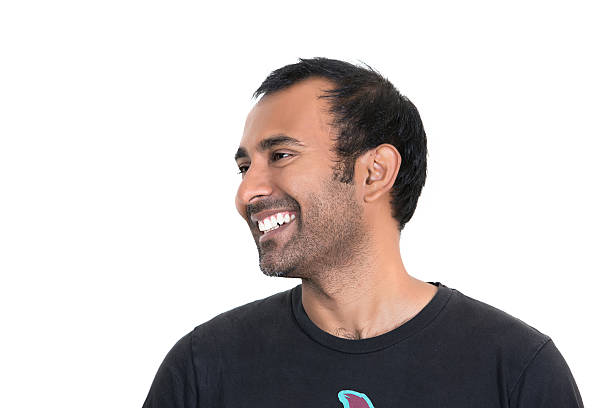 Smiling adult Indian man with a five o'clock shadow stock photo