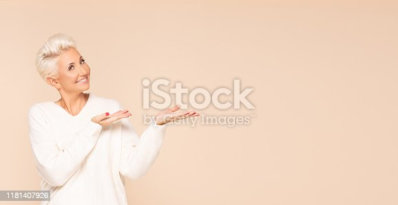 istock Smiling adult lady in cozy sweater. 1181407926