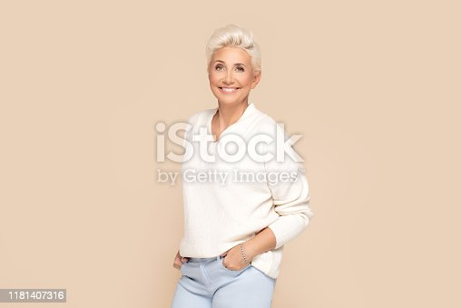 istock Smiling adult lady in white sweater. 1181407316
