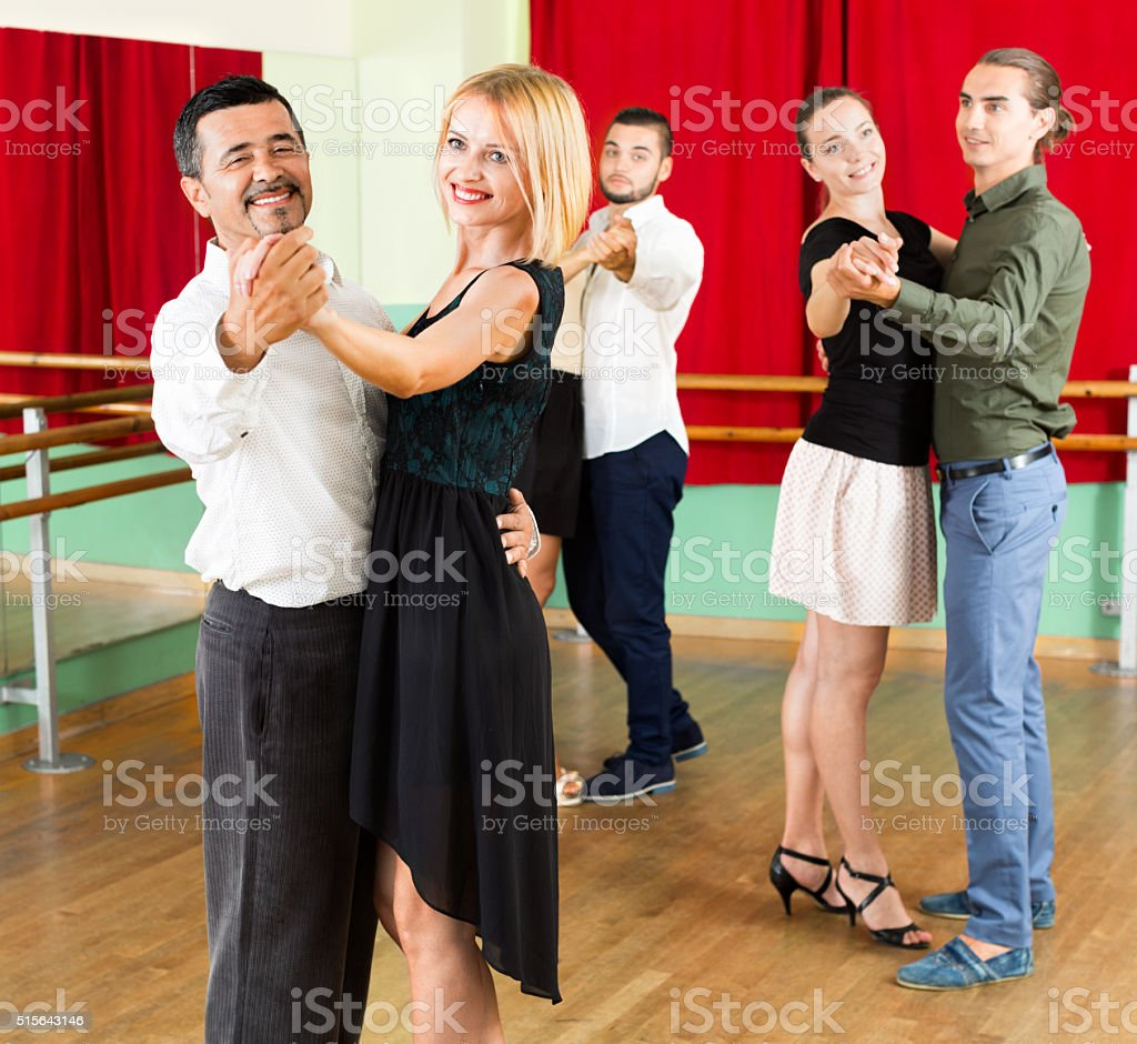 Smiling adults  enjoying of classical dance stock photo