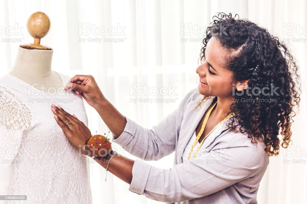 Smiling African American Black Woman Fashion Designer Standing Working And Using Tape Meter Fitting On Dress On The Mannequin At Workshop Studio Stock Photo Download Image Now Istock
