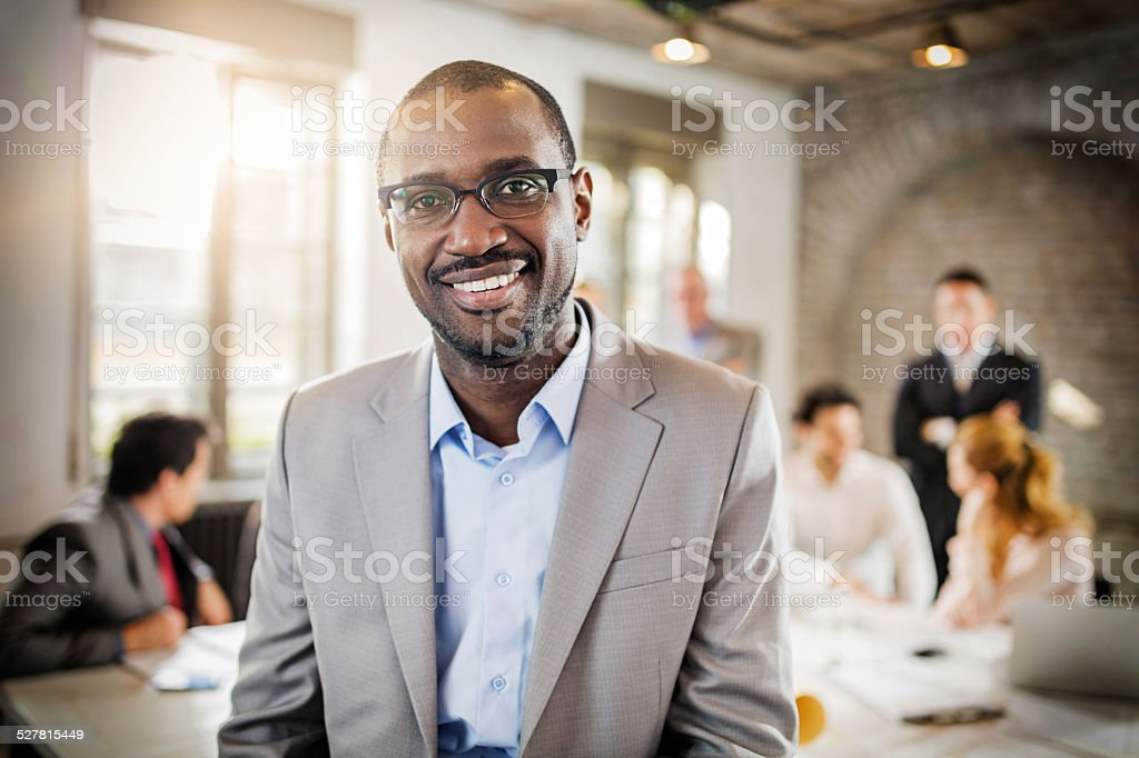 Smiling African American businessman in the office. stock photo